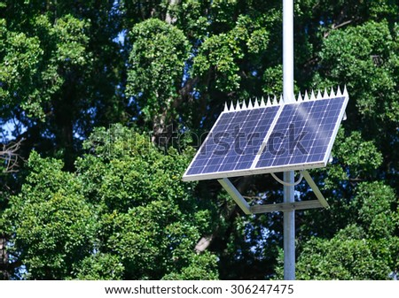 small solar panels in the nature - stock photo
