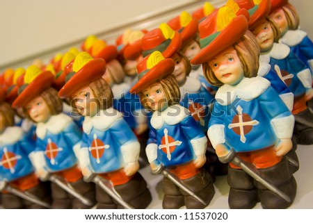 Small soldier among a group of figurines - stock photo