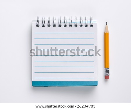 Small square notebook and pencil.