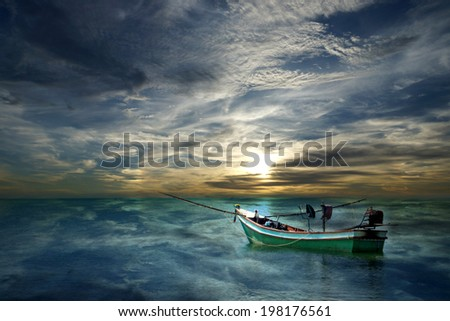 Small squid fishing boats waiting to the sea. - stock photo