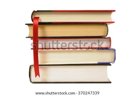 Small stack of hardcover books, red bookmark ribbon, isolated on white background. - stock photo