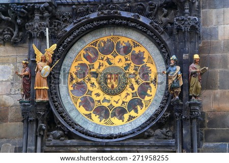 Small statues near bright dial of the Astronomical Clock, Prague Old Town, Czech Republic - stock photo