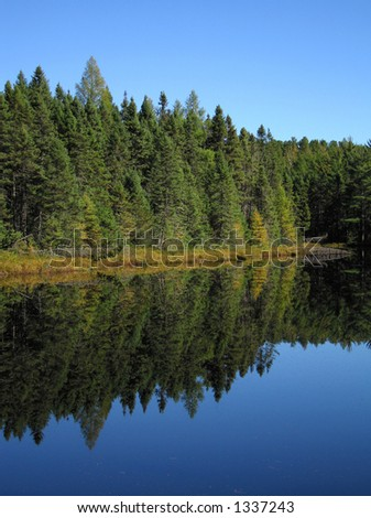 small, still lake in northern Wisconsin with - stock photo