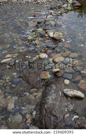 small stone and rock in the brook - stock photo