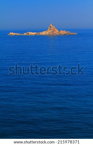 Small stone church on remote island surrounded by Mediterranean sea - stock photo