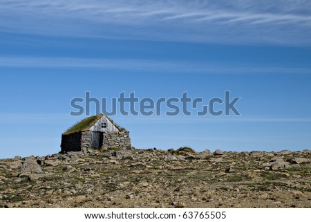 Small stone cottage in North West Iceland. - stock photo