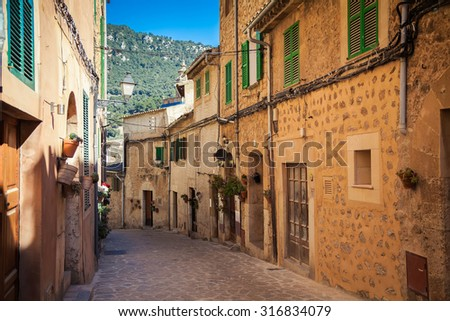 small stone street in village Valldemossa, Mallorca, Spain
