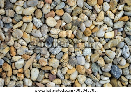 Small stones gravel texture. Naturally pebble textured background. Garden decor - stock photo