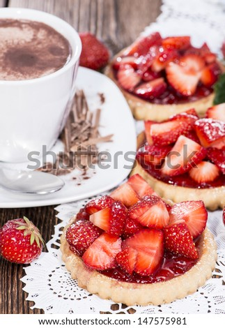 Small Strawberry Tart with fresh fruits on wooden background