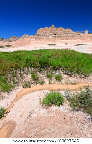 Small stream of muddy water in Badlands National Park of South Dakota - stock photo