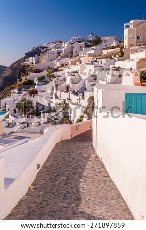 Small street in Fira city, Santorini, Greece on a sunny day - stock photo