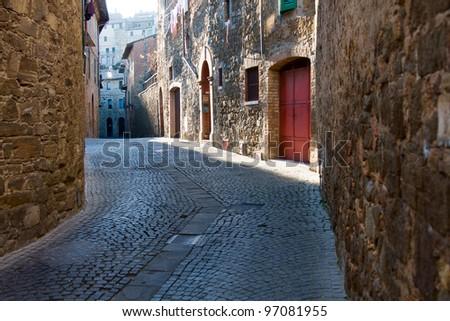 Small street in Montalcino, Tuscany. Italy - stock photo