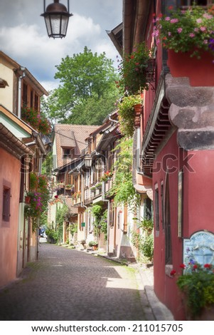 small street in village Eguisheim - stock photo
