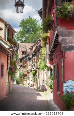 small street in village Eguisheim - stock photo