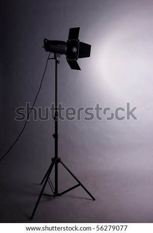 small studio flash throwing a spotlight on the wall - stock photo