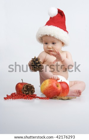 Small suckling tempts about Christmas magic,on white background. - stock photo