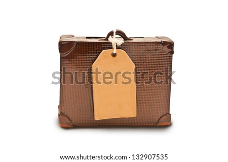 small suitcase with a tag for your text - stock photo