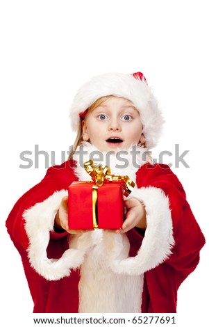 Small surprised girl dressed as santa claus holds christmas gift in hands.  Isolated on white background. - stock photo