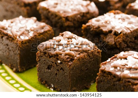 Small sweet and salry brownie bites at desesrt bar. - stock photo