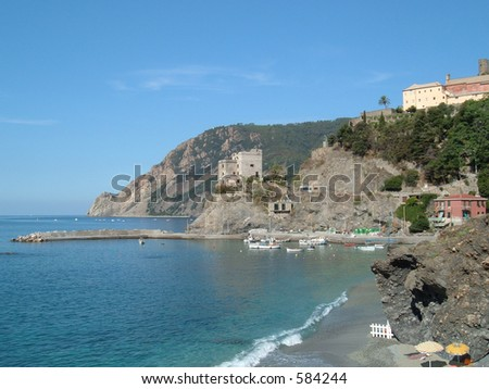 Small swimming cove near a fishing village in Italy - stock photo