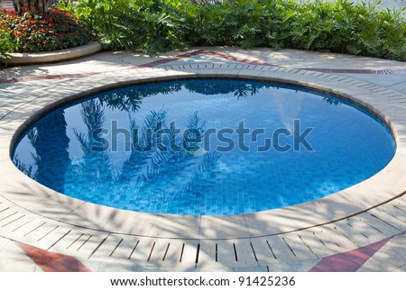 Small swimming pool in a yard - stock photo