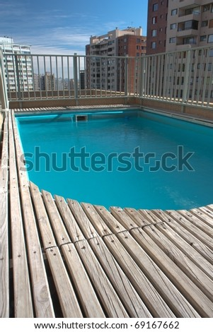 Small swimming pool on the roof - stock photo