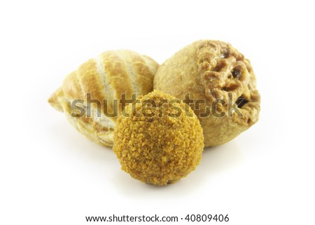 Small tasty pork pie with small sausage roll and scotch egg on a reflective white background - stock photo