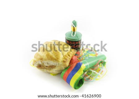Small tasty sausage roll with party blower and party popper with streamers on a reflective white background - stock photo