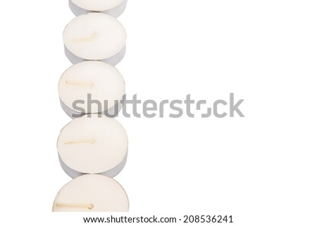 Small tealights over white background