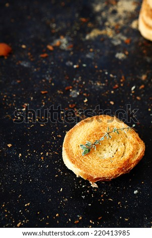 Small toast on black board,  top view - stock photo