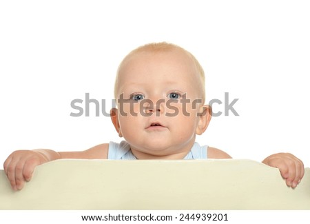 Small toddler boy in playpen - stock photo