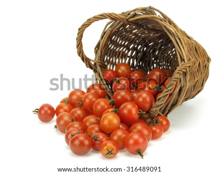 Small tomatoes in basket on a white background     - stock photo