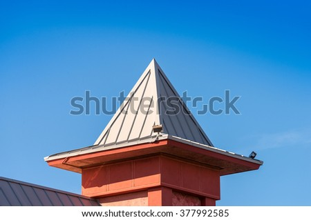 Small tower with corrugated metal roof - stock photo