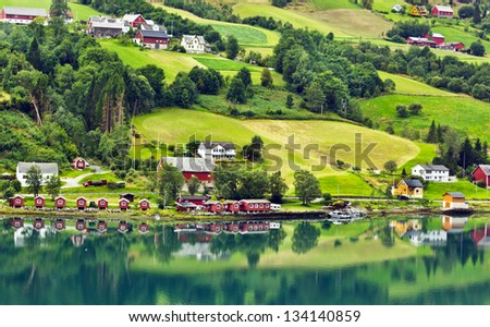 Small town and cruise port Olden in Norway. - stock photo