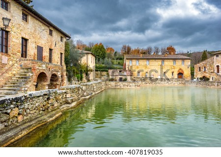 Small town famous for its hot water springs in Tuscany, Bagno Vignoni. - stock photo