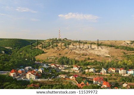 Small town in the gorge with a forest - stock photo
