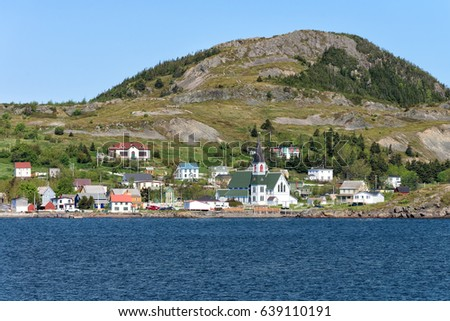 Small town of Trinity on the Atlantic Ocean with a mountain in the background in Newfoundland and Labrador, Canada