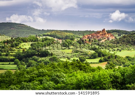 Small town on a hill in Tuscany - stock photo