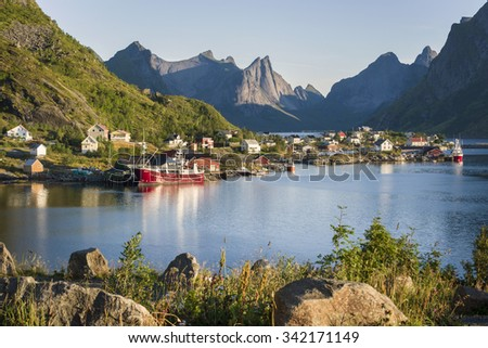 Small town Reine by the fjord on Lofoten islands in Norway - stock photo