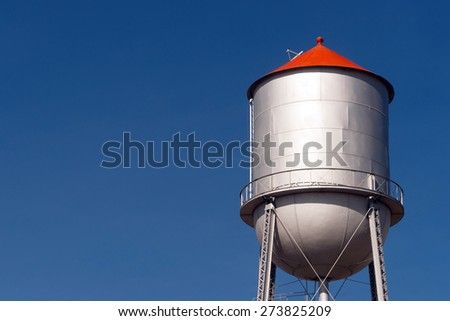 Small Town Water Tower Utility Infrastructure Storage Reservoir - stock photo