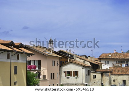 small town with a bell tower and residential buildings with blue sky - stock photo