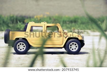 Small toy pickup in the grass - stock photo