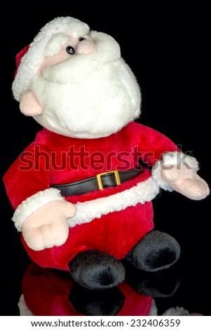 Small toy Santa and reflection - stock photo