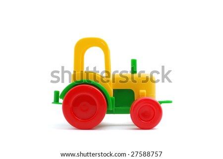 Small toy tractor a side view on white - stock photo