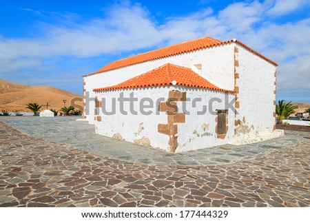 Small traditional church in Valle Santa Ines village and mountain landscape in background, Fuerteventura, Canary Islands, Spain