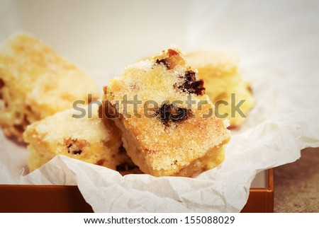 small traditional german christmas stollen pieces on parchment paper - stock photo