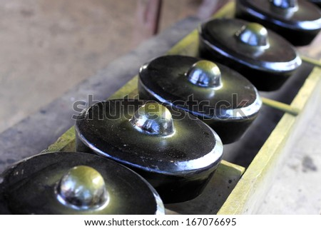 Small traditional gongs from Sabah, Borneo, Malaysia - stock photo