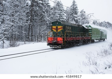 Small train moving in winter