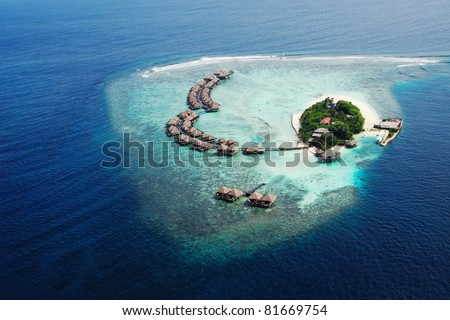 Small tropical island. View from the seaplane. Maldives,Indian ocean - stock photo