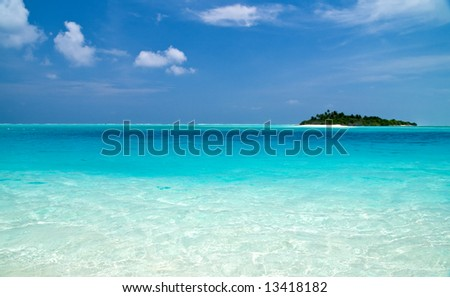 small Tropical Island with Coconut Palmtrees in the indian ocean - stock photo